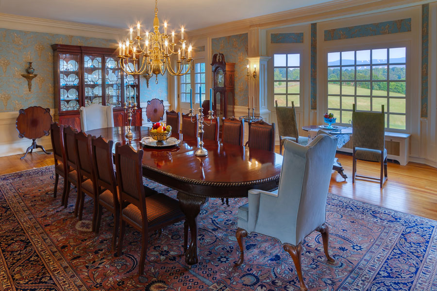 formal dining room with table for 12 people at the inn at forest oaks, natural bridge, virginia