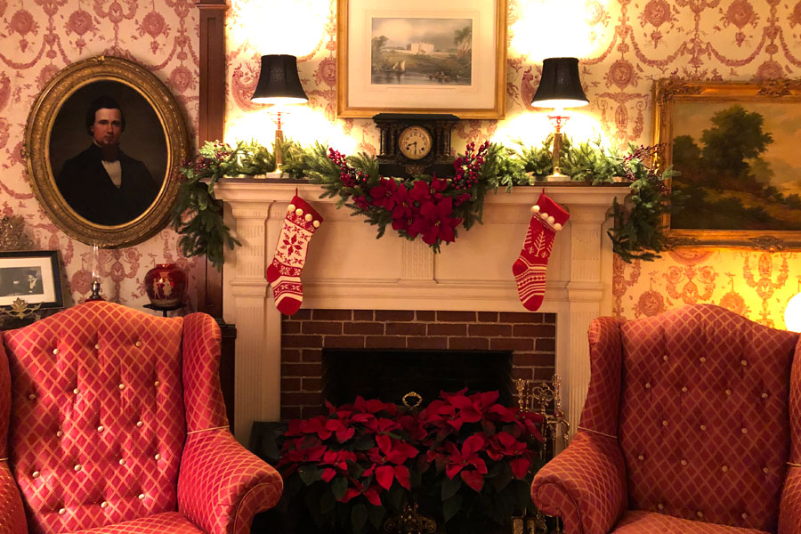 the fireplace decorated for christmas at the inn