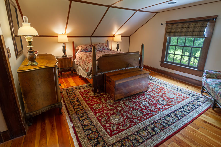 vine cottage upstairs bedroom with wood floors in natural bridge, virginia