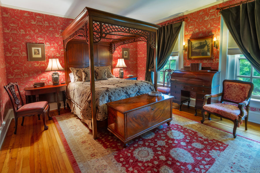 long branch guestroom with ornate antique queen bed and decor at the inn at forest oaks in natural bridge virginia