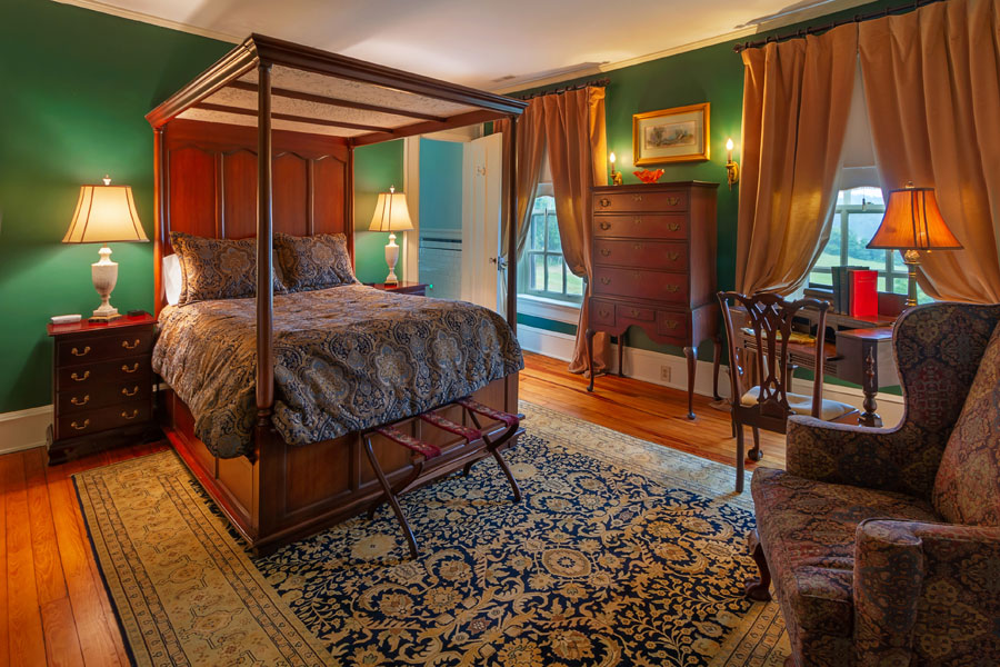 milburn guestroom with antique furniture at the inn at forest oaks in natural bridge virginia