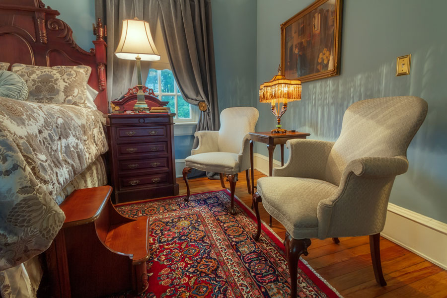 oatlands bedroom antique chairs lamp and nightstand at the inn at forest oaks in natural bridge virginia